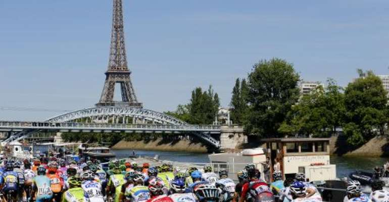 The pack rides towards the Eiffel Tower in Paris on the last stage of the 2012 Tour de France.  By Joel Saget (AFP/File)