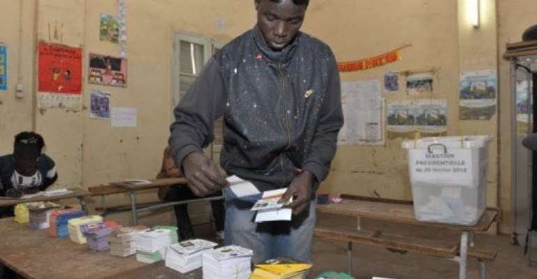 A member of the armed forces casts his ballot in Dakar ahead of presidential polls.  By Seyllou (AFP/File)