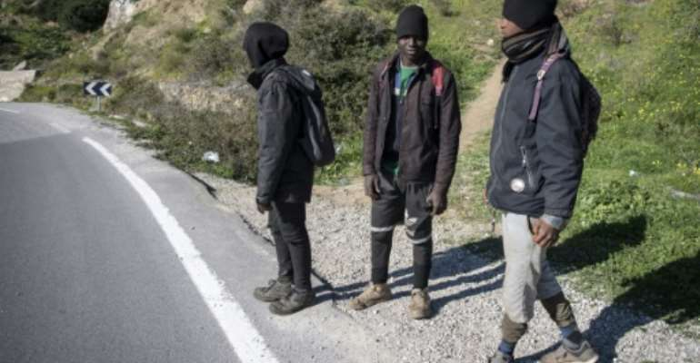 African migrants Mustapha (C) and his travel companions Ahmed and Omar are hoping to enter the Spanish enclave of Ceuta from Morocco but a clampdown is making the crossing difficult.  By FADEL SENNA (AFP)
