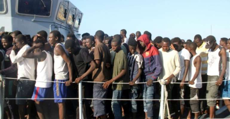 African migrants, who according to the Libyan navy were rescued by the country's coast guard, are brought to the naval base of the capital Tripoli on June 21, 2018.  By MAHMUD TURKIA (AFP)
