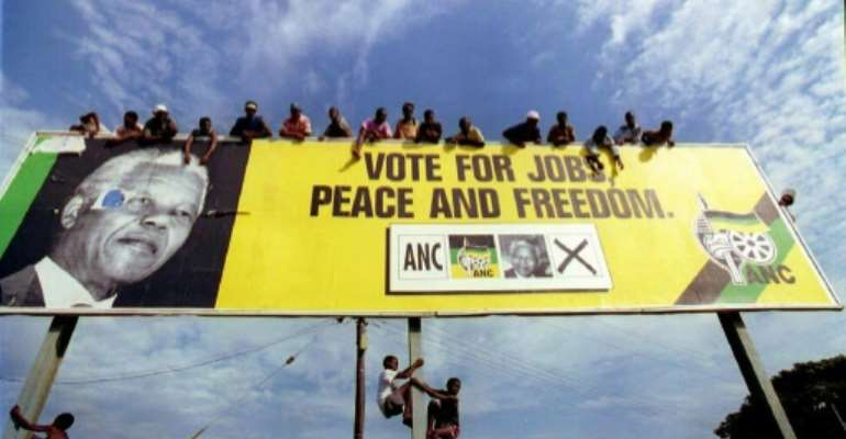 African National Congress (ANC) supporters seen waiting for Nelson Mandela when he campaigned in 1994 on the promise of a new start for South Africa after decades of apartheid rule.  By ALEXANDER JOE (AFP/File)