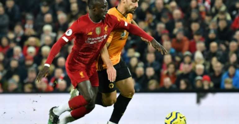 African Player of the Year favourite Sadio Mane in Premier League action for Liverpool against Wolves last weekend.  By Paul ELLIS (AFP/File)