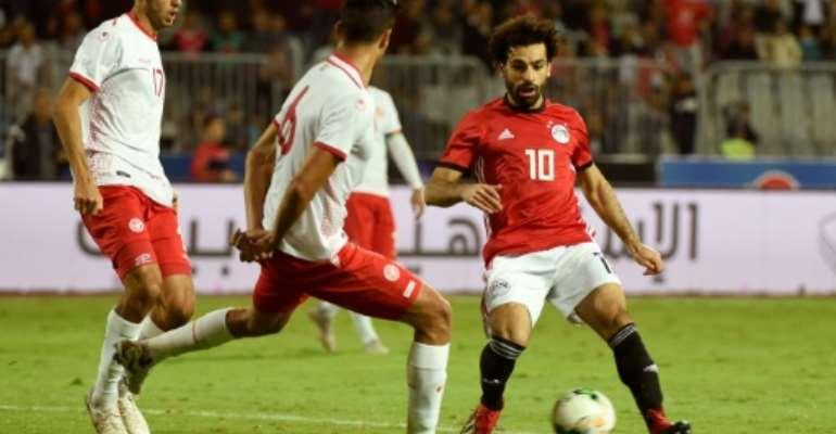 African superstar Mohamed Salah (R) playing for Egypt against Tunisia in a 2019 Africa Cup of Nations qualifier.  By KHALED DESOUKI (AFP/File)