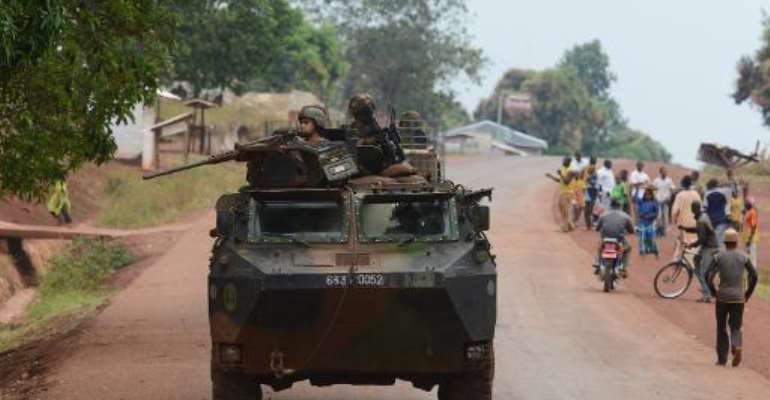 French soldiers patrol in a street in the town of Yaloke, north of Bangui, on February 2, 2014.  By Issouf Sanogo (AFP)