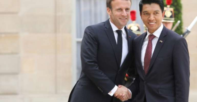 After talks with French President Emmanuel Macron (L), Madagascar President Andry Rajoelina said he believed his party and allies were on course for a majority in the country's new parliament.  By Ludovic MARIN (AFP)
