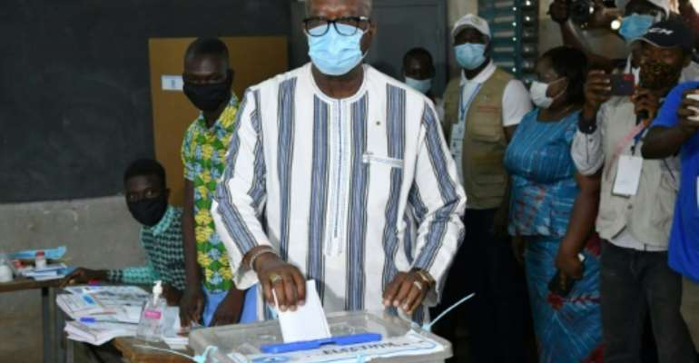 Ahead: President Roch Marc Christian Kabore, seen casting his vote in the capital Ouagadougou on Sunday.  By Issouf SANOGO (AFP)