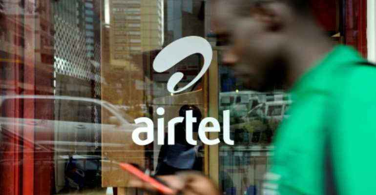 Airtel has operations in 14 African countries as it seeks to tap into the continent's vast number of young people.  By TONY KARUMBA (AFP/File)