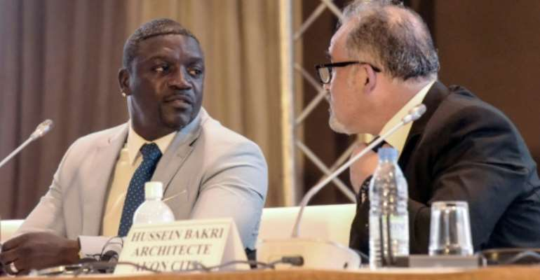 Akon said he told architect Hussein Bakri -- pictured to his left at the press conference --