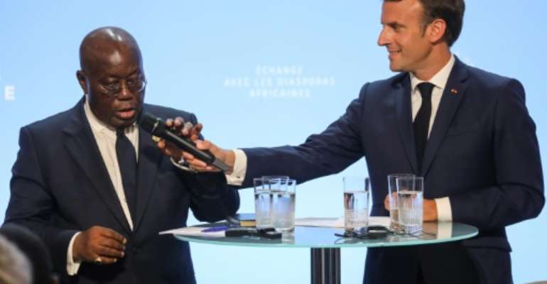 Akufo-Addo told Macron the time had come for Africans to take charge of their future.  By ludovic MARIN (POOL/AFP)