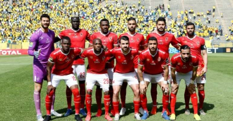 Al Ahly pose before drawing with Mamelodi Sundowns in a 2020 CAF Champions League quarter-final in South Africa.  By Phill Magakoe (AFP/File)