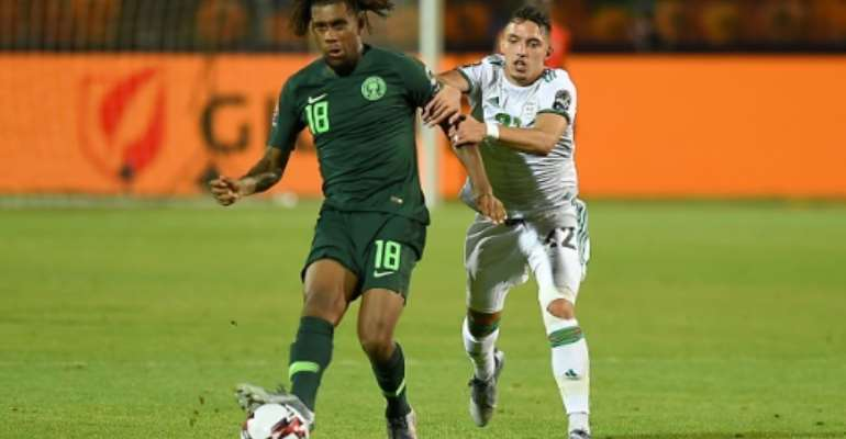 Alex Iwobi (L) scored twice as Nigeria took a four-goal lead before collapsing in a 4-4 draw against Sierra  Leone Friday..  By MOHAMED EL-SHAHED (AFP)