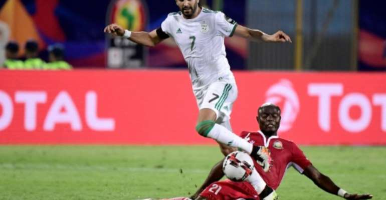 Algeria and Manchester City winger Riyad Mahrez takes the ball past Kenyan Dennis Odhiambo in an Africa Cup of Nations match won 2-0 by the Desert Foxes.  By JAVIER SORIANO (AFP)