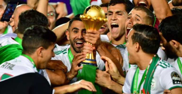 Algeria captain Riyad Mahrez (C) and team-mates celebrate winning the Africa Cup of Nations in Cairo this month.  By Giuseppe CACACE (AFP)