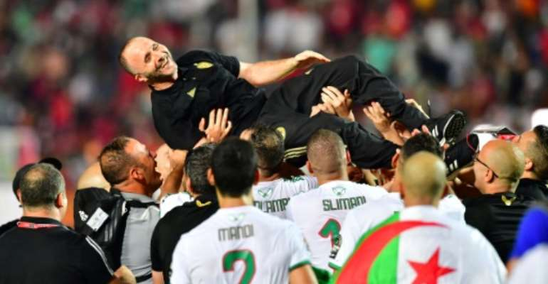 Algeria coach Djamel Belmadi is hoisted aloft by his players after leading the country to a second Africa Cup of Nations title.  By Giuseppe CACACE (AFP)
