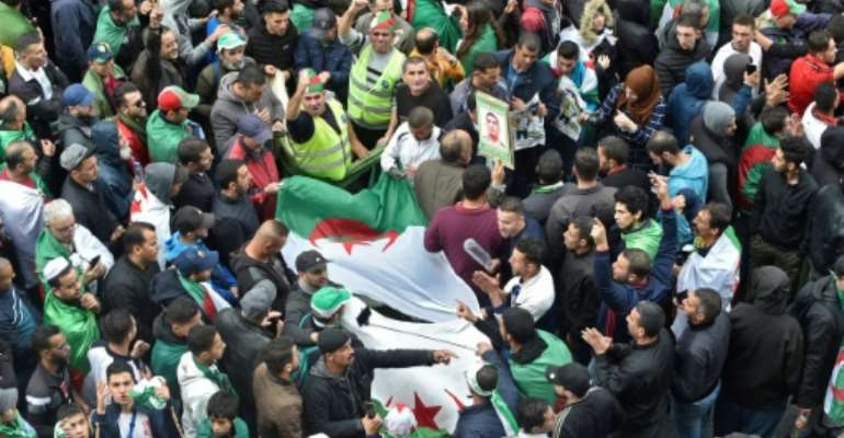Algeria has been gripped by months of anti-government protests demanding an overhaul of the political leadership and opposed to a presidential election involving figures from the Bouteflika era.  By RYAD KRAMDI (AFP)