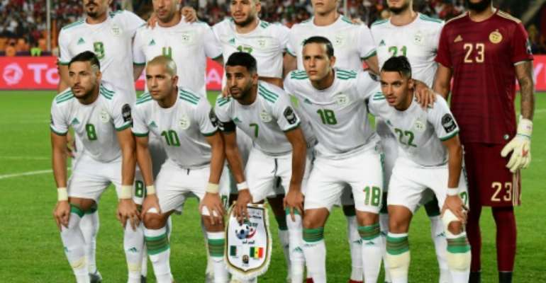 Algeria pose before defeating Senegal in the 2019 African Cup of Nations final in Cairo..  By Giuseppe CACACE (AFP)