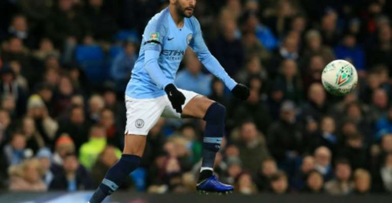 Algeria qualified for the Africa Cup of Nations in their most recent game against Togo with the help of Riyad Mahrez, pictured here playing for Manchester City in November 2018.  By Lindsey PARNABY (AFP/File)