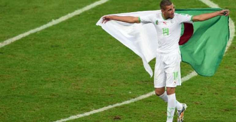 Algeria's midfielder Nabil Bentaleb celebrates his team's victory after a Group H football match at The Baixada Arena in Curitiba on June 26, 2014.  By Pedro Ugarte (AFP/File)