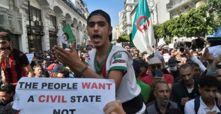 Algerian anti-government protesters take to the streets in the capital Algiers as the Hirak pro-democracy movement keeps up its weekly protesters.  By RYAD KRAMDI (AFP)