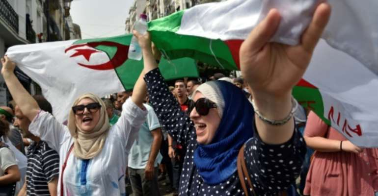 Algerian demonstrators have been staging mass rallies since February.  By RYAD KRAMDI (AFP)