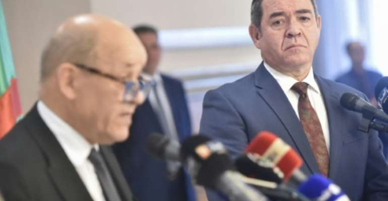 Algerian Foreign Minister Sabri Boukadoum (R) listens to his French counterpart Jean-Yves Le Drian during a joint press conference in the capital Algiers.  By RYAD KRAMDI (AFP)