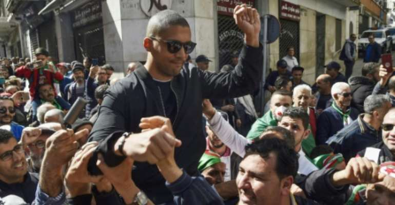 Algerian journalist Khaled Drareni, 40, was arrested on March 29 on charges of 'inciting an unarmed gathering' and 'endangering national unity' after covering demonstrations by anti-government protesters.  By RYAD KRAMDI (AFP)