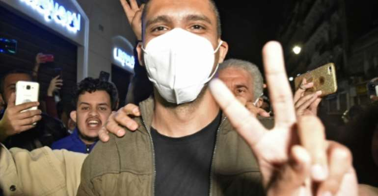 Algerian journalist Khaled Drareni greeted by supporters upon his release on February 19.  By RYAD KRAMDI (AFP)