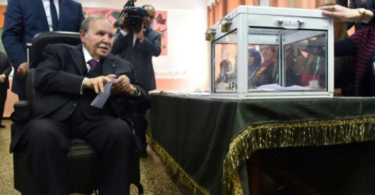 Algerian President Abdelaziz Bouteflika casting his ballot during parliamentary elections in 2017.  By RYAD KRAMDI (AFP/File)