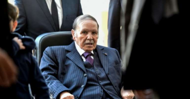 Algerian President Abdelaziz Bouteflika in November 2017 during a rare public appearance after suffering a stroke.  By RYAD KRAMDI (AFP/File)