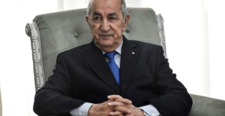 Algerian President Abdelmadjid Tebboune, pictured in January 2020, has been treated for Covid-19 in a specialised hospital in Germany since late October.  By RYAD KRAMDI (AFP/File)