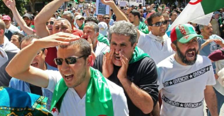 Algerian protesters brave blazing sunshine to press their demands for reform on the first Friday mass rally of Ramadan in Algiers.  By - (AFP)