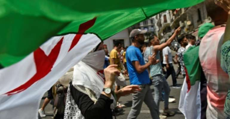 Algerian protesters demonstrate in Algiers calling for an overhaul of the country's political system.  By RYAD KRAMDI (AFP)