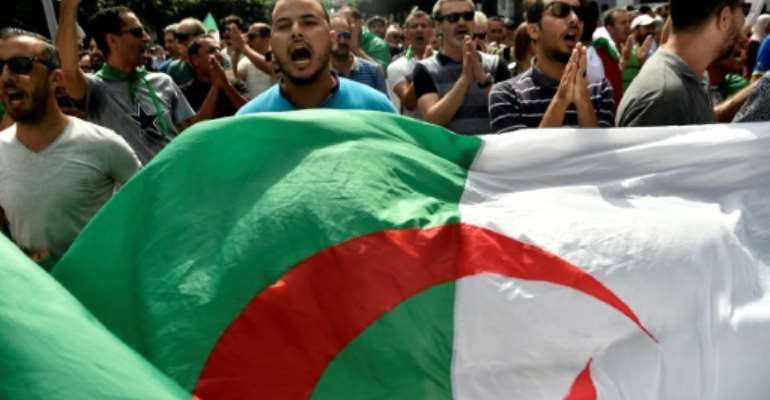 Algerian protesters have been demanding sweeping reforms including the departure of powerful army chief Ahmed Gaid Salah.  By RYAD KRAMDI (AFP/File)