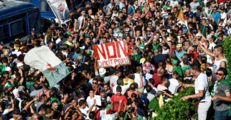 Algerian protesters have continued with their weekly mass demonstrations since President Abdelaziz Bouteflika resigned in April.  By RYAD KRAMDI (AFP)