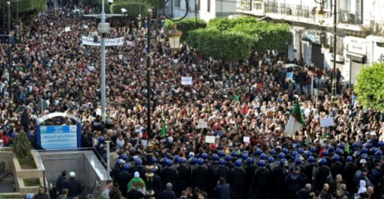 Algerian protesters have marched weekly since February and say sweeping reforms must be made before a presidential election on Thursday they see as a regime ploy to cling to power.  By RYAD KRAMDI (AFP)