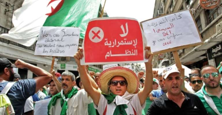 Algerian protesters on Friday braved a large police presence and called for civil disobedience for the first time since they began taking to the streets nearly six months ago.  By - (AFP)