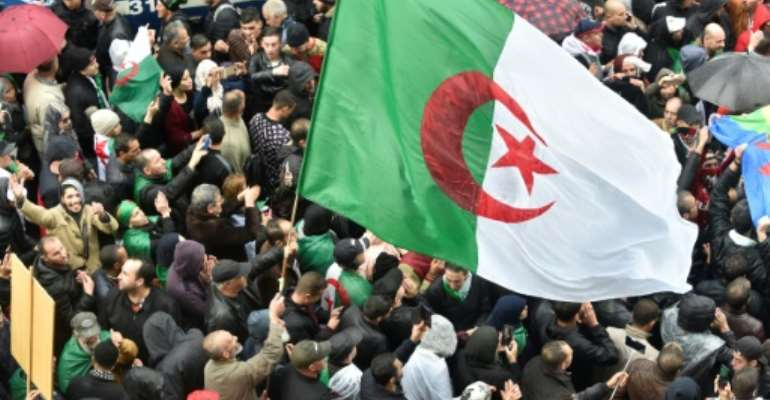 Algerian protesters rally to reiterate their opposition to the December presidential election which they say will keep Bouteflika-era politicians in power.  By RYAD KRAMDI (AFP)