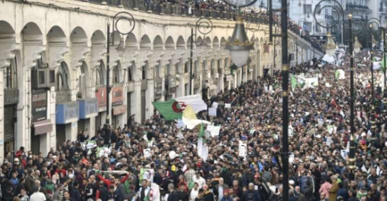 Algerian protesters take part in an anti-government demonstration in the capital Algiers on December 27, 2019 for the 45th Friday in a row.  By RYAD KRAMDI (AFP)