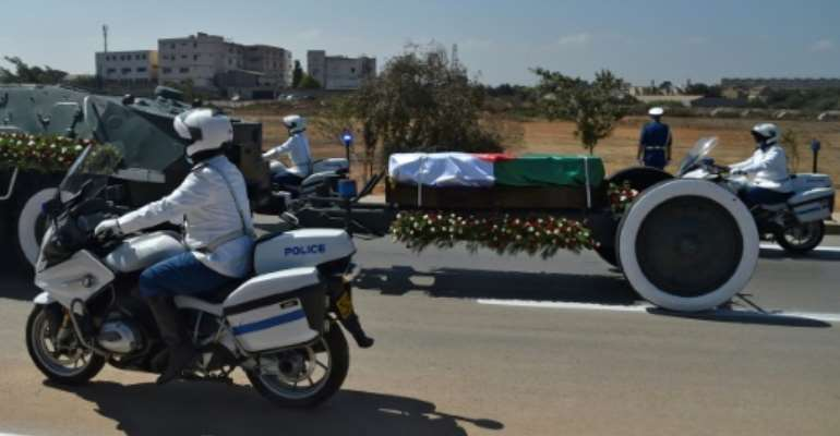 Algerian security forces escort the coffin of former president Abdelaziz Bouteflika to El-Alia cemetery in the capital Algiers on September 19, 2021.  By Ryad KRAMDI (AFP)