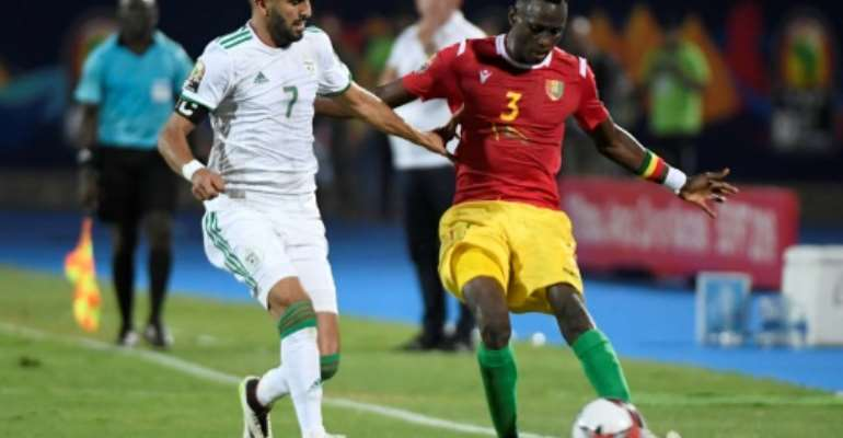 Algerian star Riyad Mahrez (L) tries to prevent Guinean Issiaga Sylla crossing during an Africa Cup of Nations last-16 match in Cairo.  By Khaled DESOUKI (AFP)