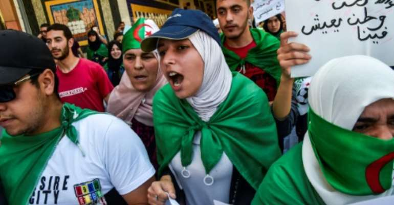 Algerian students took to the streets in the latest push to pressure the ruling elite for more change.  By RYAD KRAMDI (AFP)