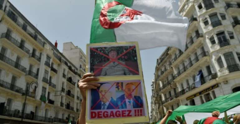 Algerians demonstrate for a 16th consecutive Friday demanding a political overhaul in the North African country after the ouster in April of veteran president Abdelaziz Bouteflika before new presidential polls can be held.  By RYAD KRAMDI (AFP)