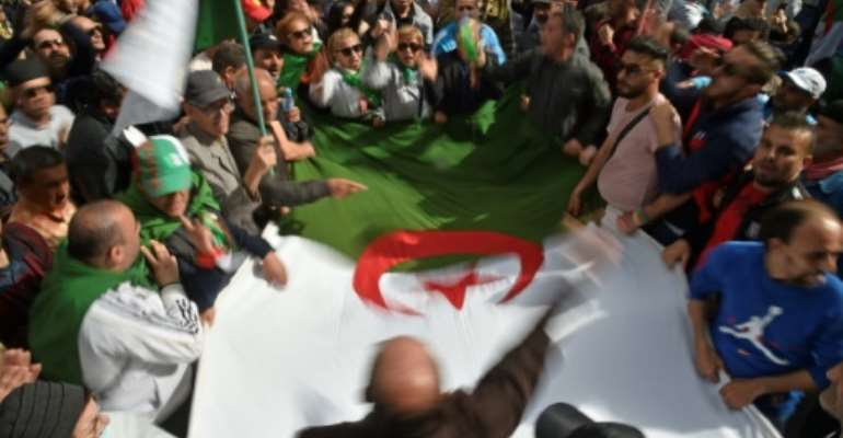 Algerians have been staging weeky  anti-government protests despite a ban on large gatherings as part of measures to contain the coronavirus.  By RYAD KRAMDI (AFP)