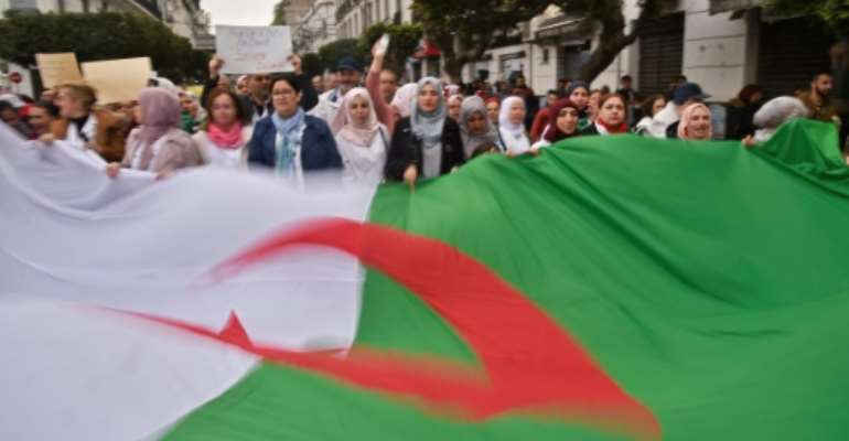 Algerians have demonstrated in their tens of thousands against Bouteflika's bid for another term as president.  By RYAD KRAMDI (AFP)