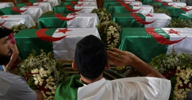 Algerians paid their respects before the 24 coffins of anti-colonial resistance fighters repatriated to Algiers by France before their burial.  By RYAD KRAMDI (AFP)