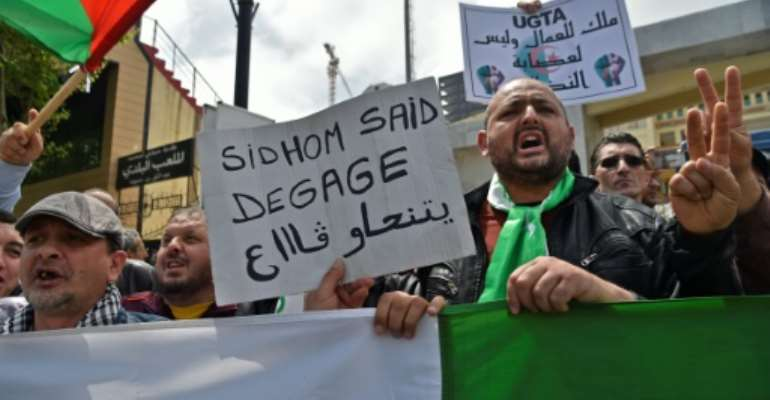 Algerians rallied Wednesday outside the powerful General Union of Algerian Workers (UGTA) headquarters.  By RYAD KRAMDI (AFP)