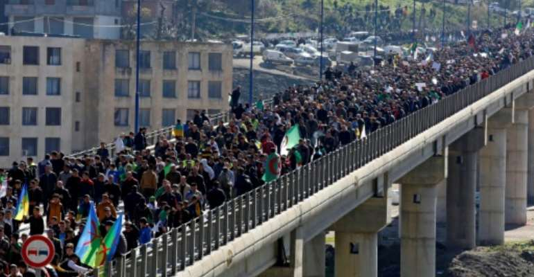 Algerians rally in the northern town of Kherrata to demand sweeping political reforms.  By - (AFP)