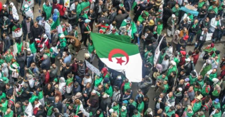 Algerians staged massive demonstrations again on Friday demanding that key figures from former president Abdelaziz Bouteflika's regime follow his lead and quit.  By - (AFP)