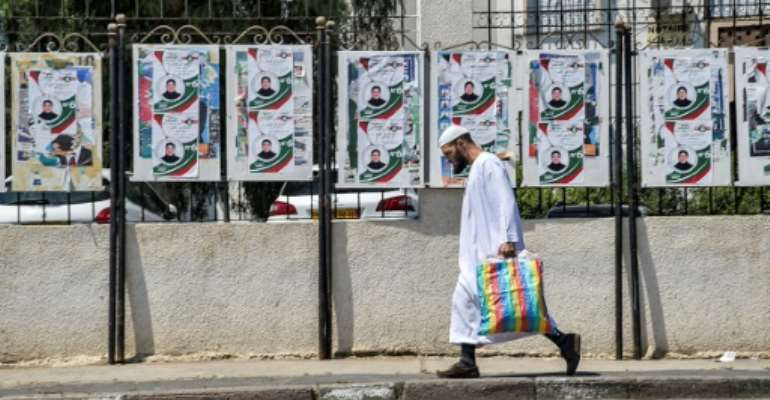 Algerians vote in parliamentary elections on Saturday although opposition activists have called for people to boycott the poll.  By RYAD KRAMDI (AFP)