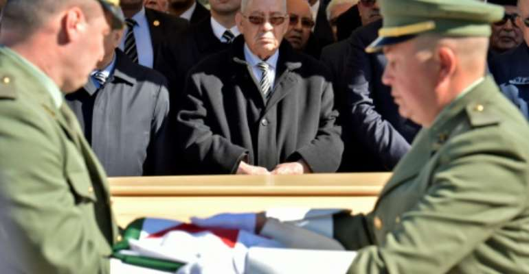 Algeria's armed forces chief Ahmed Gaid Salah (centre) has emerged as a de facto strongman since long-serving president Abdelaziz Bouteflika stepped down on April 2 in the face of massive protests..  By RYAD KRAMDI (AFP/File)